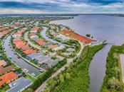 Kayak, paddleboard, nature trail, observation pier for fishing, playground, tennis courts and of course boating are all activities to be done behind the secure gates of Harbour Walk! - Single Family Home for sale at 595 Fore Dr, Bradenton, FL 34208 - MLS Number is A4428657