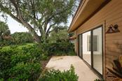Back lanai and sliding glass doors. - Condo for sale at 1742 Landings Blvd #38, Sarasota, FL 34231 - MLS Number is A4439252