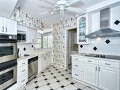 Kitchen - Newer Stainless Steel Appliances - Single Family Home for sale at 225 John Ringling Blvd, Sarasota, FL 34236 - MLS Number is A4443640
