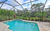 Private pool with Travertine deck ....note and enjoy the privacy! - Single Family Home for sale at 8260 Larkspur Cir, Sarasota, FL 34241 - MLS Number is A4455087
