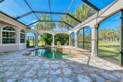 Pool looking westward - Single Family Home for sale at 3719 Founders Club Dr, Sarasota, FL 34240 - MLS Number is A4455099