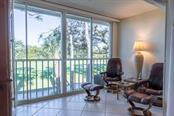 Glassed-in lanai adds extra square footage - Condo for sale at 9570 High Gate Dr #1722, Sarasota, FL 34238 - MLS Number is A4457005