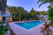 Poolside Suite View of Courtyard, Pool & Guesthouse - Single Family Home for sale at 7340 Point Of Rocks Rd, Sarasota, FL 34242 - MLS Number is A4461841