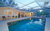 BEAUTIFUL PEBBLE TEC POOL WITH MANY AREAS TO LOUNGE! - Single Family Home for sale at 3 Winslow Pl, Longboat Key, FL 34228 - MLS Number is A4464990