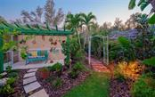 THE BACKYARD HAS FABULOUS PLANTINGS & AN OUTSIDE SHOWER THRU THAT TRELLIS - Single Family Home for sale at 3 Winslow Pl, Longboat Key, FL 34228 - MLS Number is A4464990