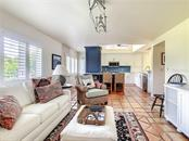 Family room is open to the kitchen, full of light and great entertaining flow. - Townhouse for sale at 69 Tidy Island Blvd #69, Bradenton, FL 34210 - MLS Number is A4471437