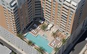 Aerial shot of the pool deck - Condo for sale at 1350 Main St #701, Sarasota, FL 34236 - MLS Number is A4472236