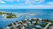 Aerial view of Bimini Bay and Tampa Bay. - Single Family Home for sale at 718 Key Royale Dr, Holmes Beach, FL 34217 - MLS Number is A4480381