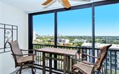 A lengthy balcony that runs nearly 40 feet across the entire rear of the unit connects the primary, guest bedroom, and living area for increased flow of the unit. - Condo for sale at 707 S Gulfstream Ave #1002, Sarasota, FL 34236 - MLS Number is A4484781