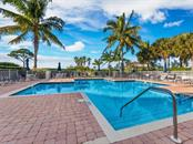 Bayfront swimming pool. - Condo for sale at 14021 Bellagio Way #407, Osprey, FL 34229 - MLS Number is A4487552