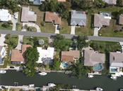 Aerial of residence - in center of photograph. - Single Family Home for sale at 1633 Ridgewood Ln, Sarasota, FL 34231 - MLS Number is A4496839