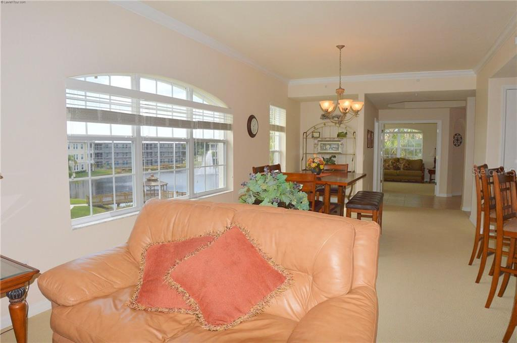 Living Room to Dining Room - Condo for sale at 1100 San Lino Cir #1134, Venice, FL 34292 - MLS Number is N5910364