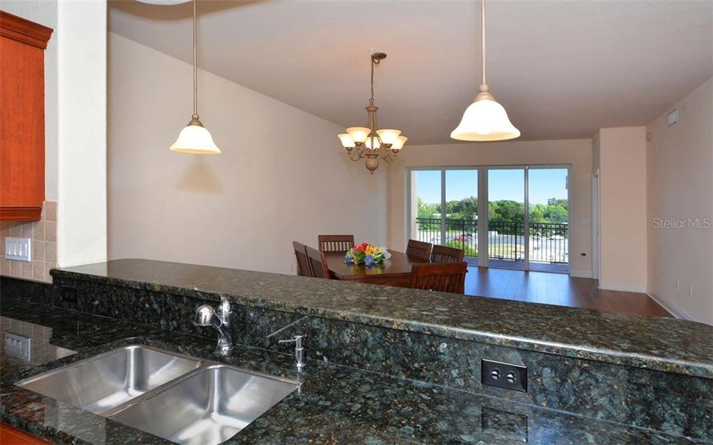 Kitchen to Dining Room/Great Room - Condo for sale at 167 Tampa Ave E #513, Venice, FL 34285 - MLS Number is N5911190