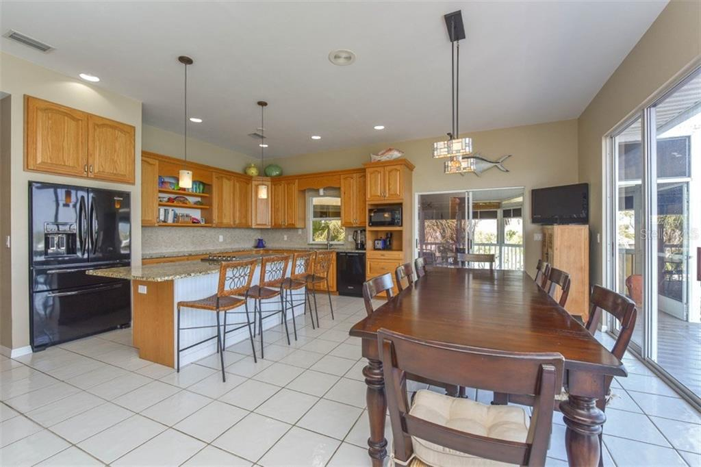 Dining room to kitchen - Single Family Home for sale at 725 El Dorado Dr, Venice, FL 34285 - MLS Number is N5911780