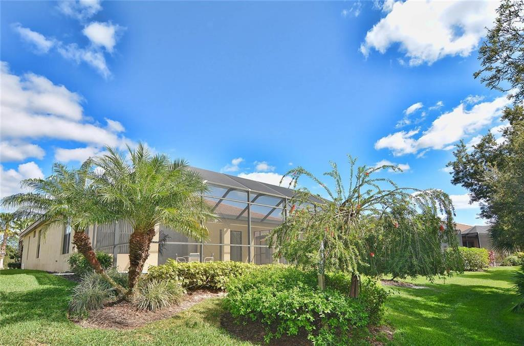Rear exterior - Single Family Home for sale at 1975 Batello Dr, Venice, FL 34292 - MLS Number is N5911919