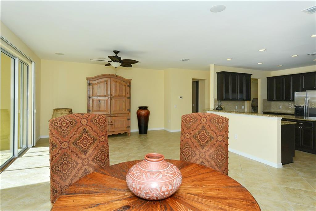 Great room to kitchen - Single Family Home for sale at 19168 Jalisca St, Venice, FL 34293 - MLS Number is N5912651