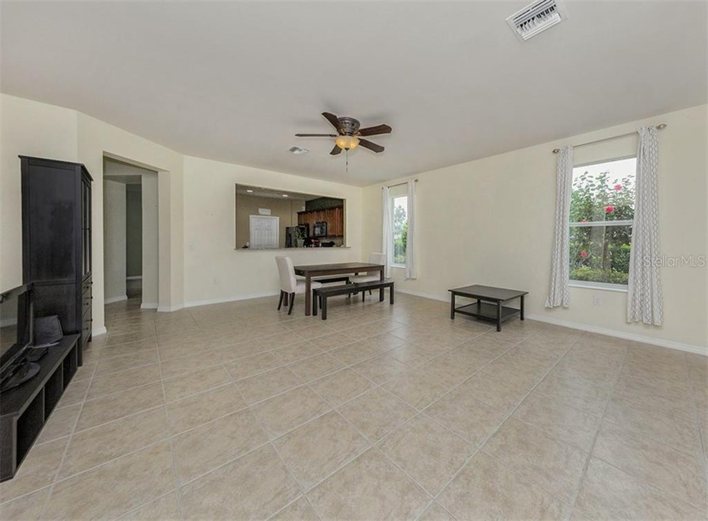 Great room to kitchen. - Single Family Home for sale at 19131 Kirella St, Venice, FL 34293 - MLS Number is N5913074