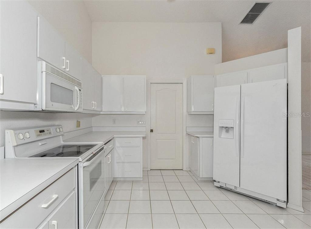 Kitchen - Single Family Home for sale at 683 May Apple Way, Venice, FL 34293 - MLS Number is N5913909