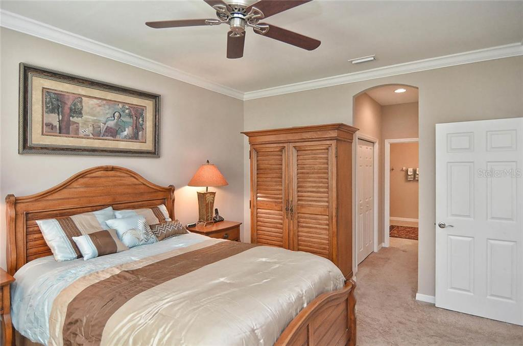 Maser bedroom to master bath - Single Family Home for sale at 9124 Coachman Dr, Venice, FL 34293 - MLS Number is N5914408