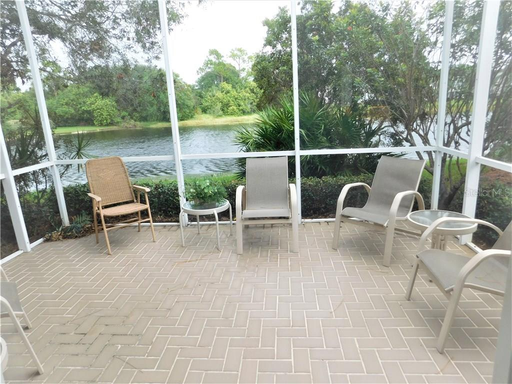 Patio with a lake view - Villa for sale at 900 Tartan Dr #28, Venice, FL 34293 - MLS Number is N5914495