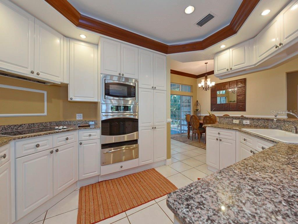 Kitchen with Granite Countertops...open concept and perfect for entertaining. - Single Family Home for sale at 200 Sunrise Dr, Nokomis, FL 34275 - MLS Number is N5914820