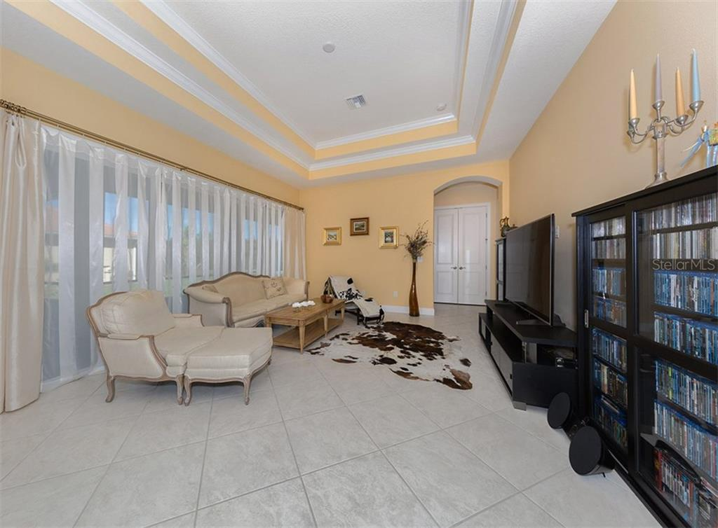 Family room - Single Family Home for sale at 221 Portofino Dr, North Venice, FL 34275 - MLS Number is N5914925