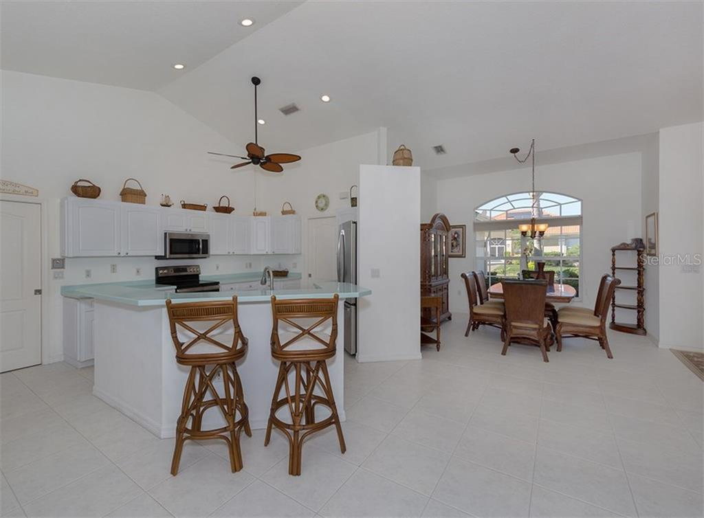 Kitchen, dining room - Single Family Home for sale at 866 Wood Sorrel Ln, Venice, FL 34293 - MLS Number is N5915362