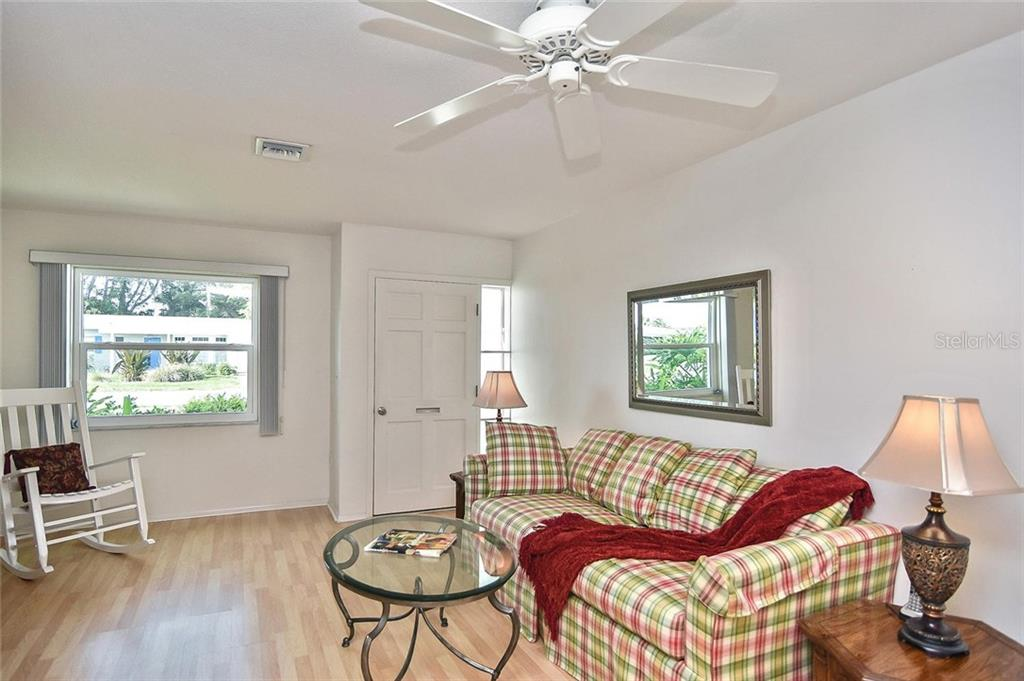 Dining room to kitchen and living room - Condo for sale at 139 Field Ave E #139, Venice, FL 34285 - MLS Number is N5915558