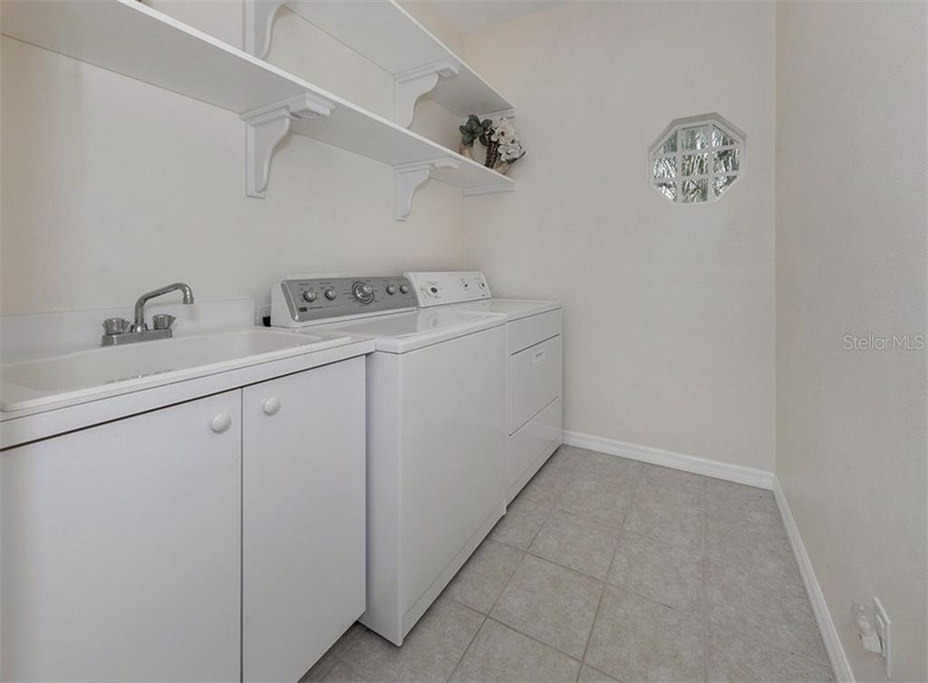 Utility room - Single Family Home for sale at 2196 Calusa Lakes Blvd, Nokomis, FL 34275 - MLS Number is N5915879
