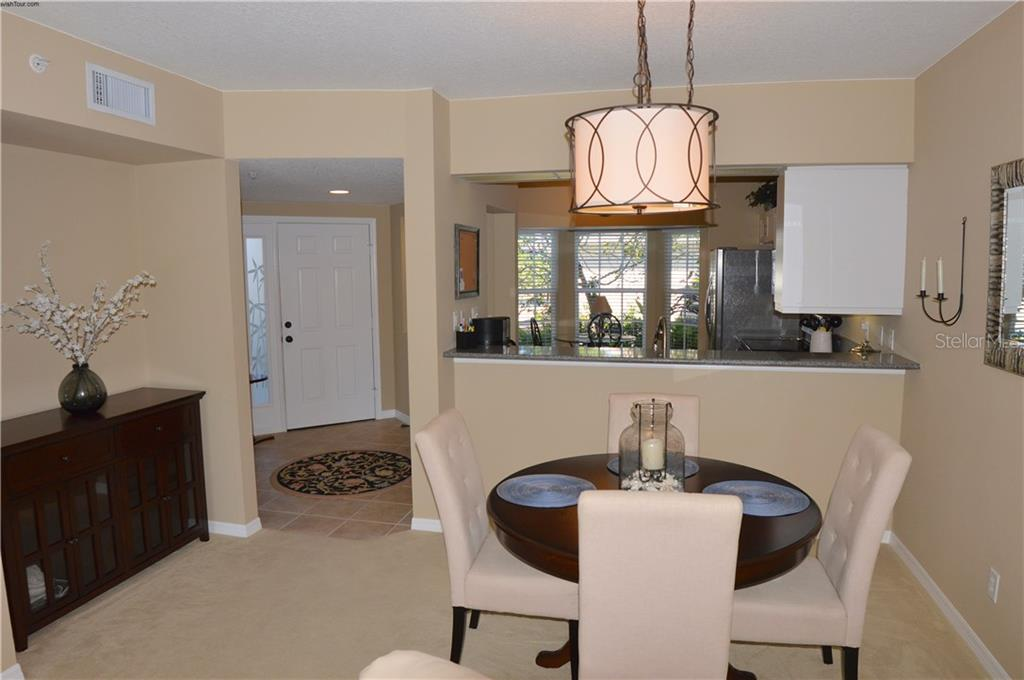 Dining room to foyer and kitchen - Condo for sale at 903 Addington Ct #102, Venice, FL 34293 - MLS Number is N5916962