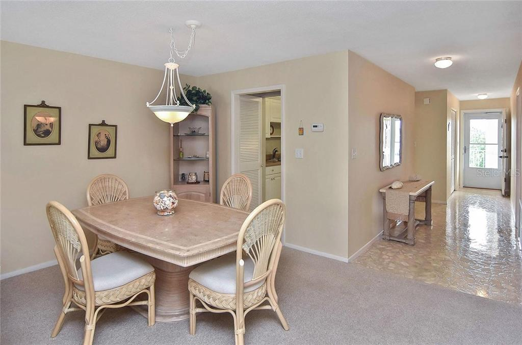 Dining room to kitchen and foyer - Condo for sale at 500 The Esplanade N #402, Venice, FL 34285 - MLS Number is N6100557