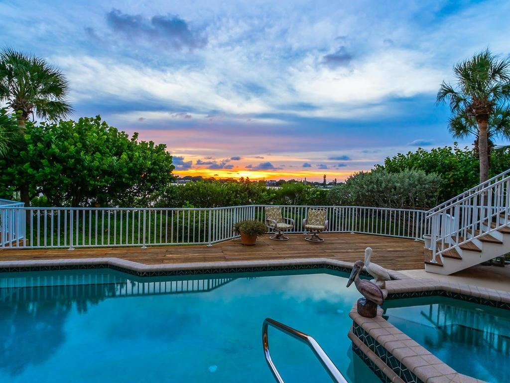 Sunset view from pool area - Single Family Home for sale at 743 Eagle Point Dr, Venice, FL 34285 - MLS Number is N6101092