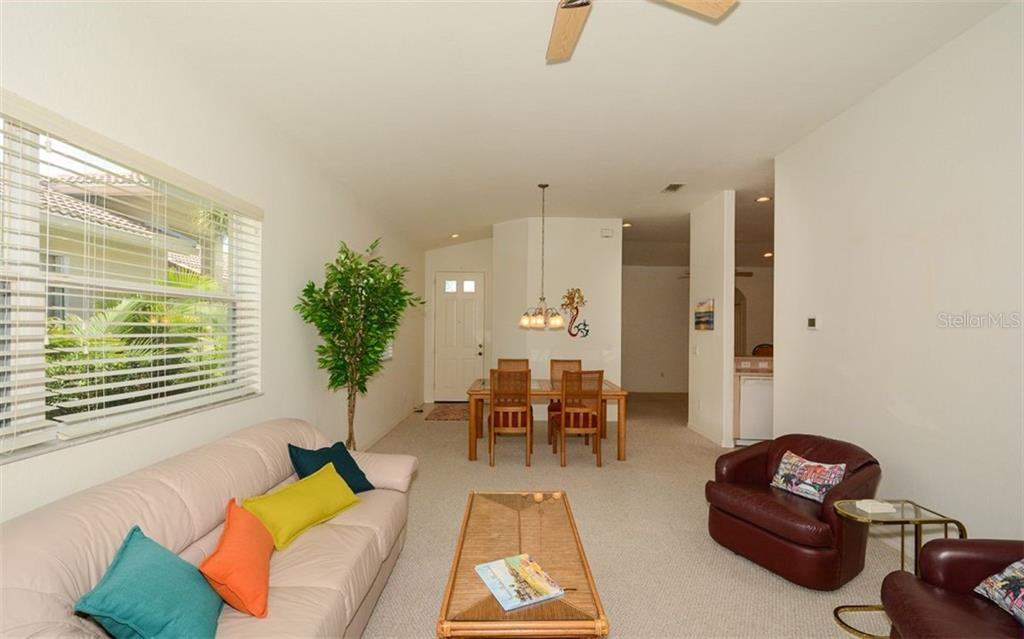 Great room to dining area and foyer - Villa for sale at 313 Auburn Woods Cir, Venice, FL 34292 - MLS Number is N6101432