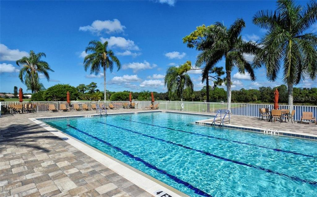 Clubhouse heated pool - Single Family Home for sale at 979 Chickadee Dr, Venice, FL 34285 - MLS Number is N6102266