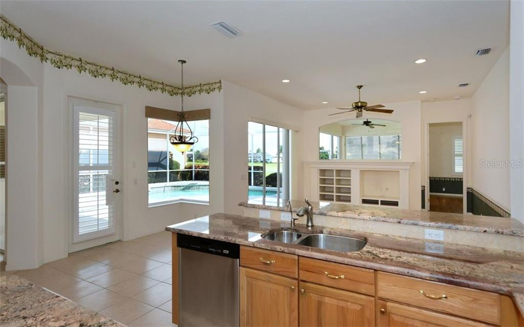 Kitchen to breakfast room - Single Family Home for sale at 969 Chickadee Dr, Venice, FL 34285 - MLS Number is N6102722