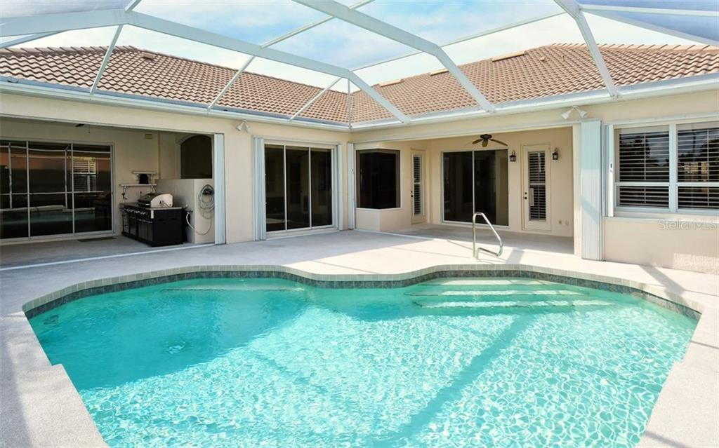 Pool, lanai - Note: All accordion shutters - Single Family Home for sale at 969 Chickadee Dr, Venice, FL 34285 - MLS Number is N6102722