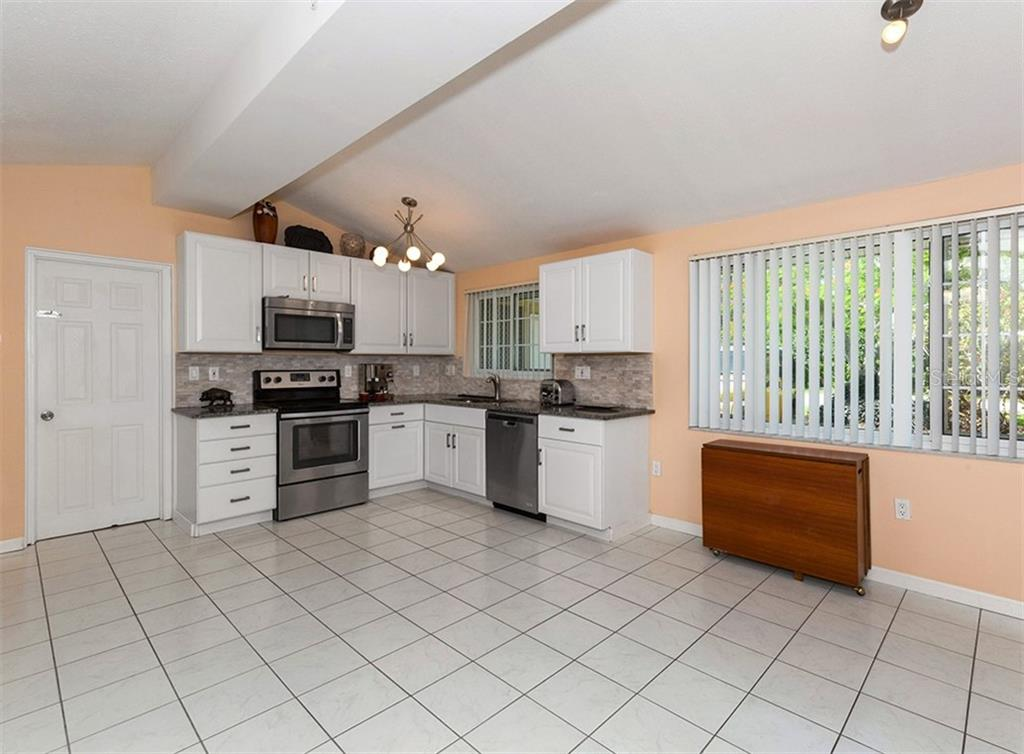Kitchen - Single Family Home for sale at 717 Guild Dr, Venice, FL 34285 - MLS Number is N6103134