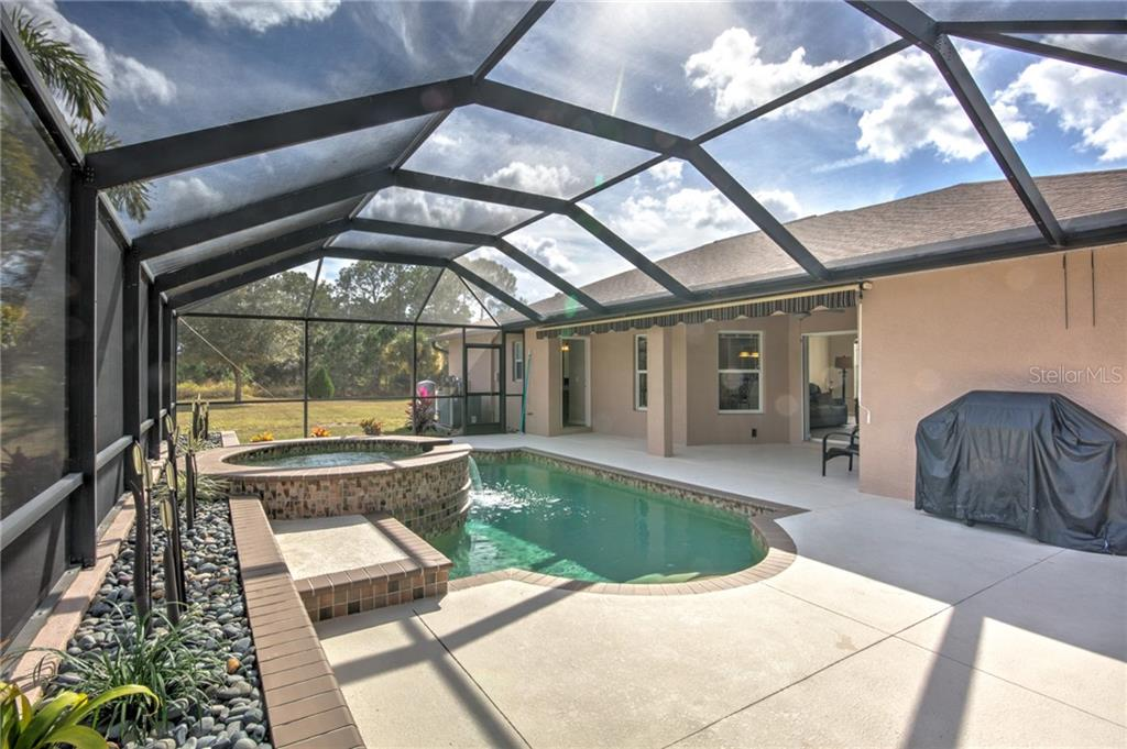 Plenty of space to the left of the house - Single Family Home for sale at 6612 Deer Run Rd, North Port, FL 34291 - MLS Number is N6103231