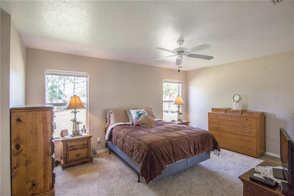 Master bedroom - Single Family Home for sale at 6612 Deer Run Rd, North Port, FL 34291 - MLS Number is N6103231