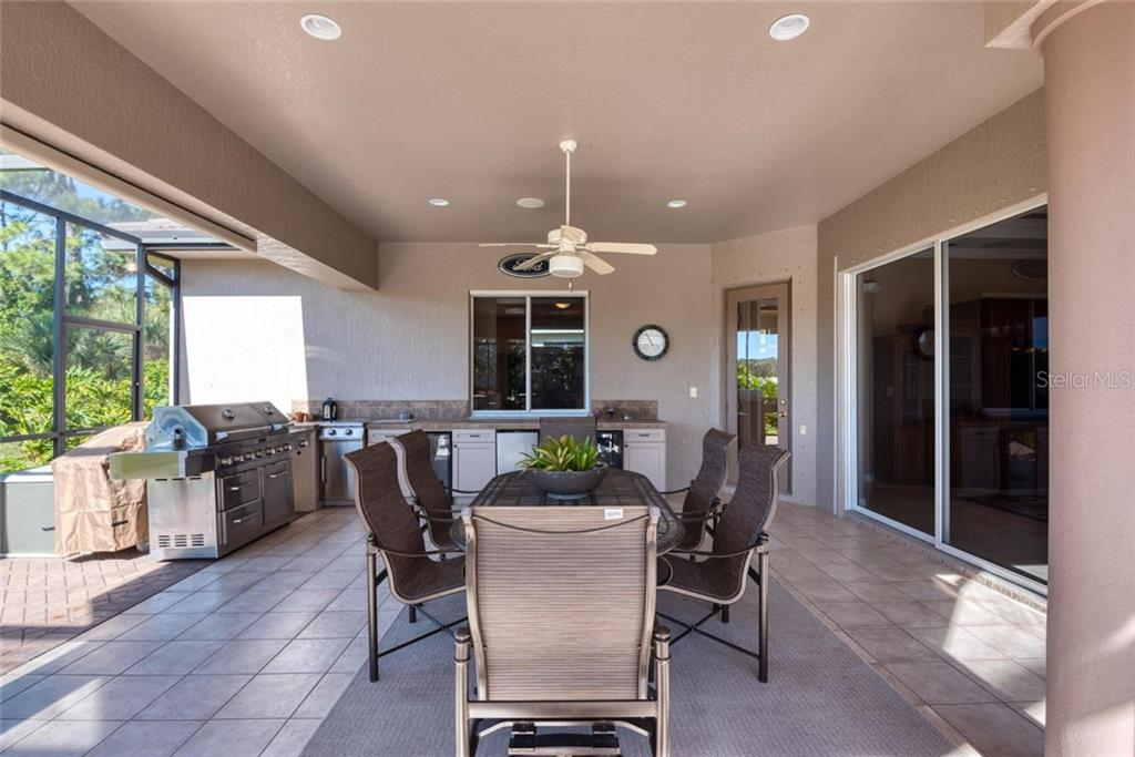 Cabana with outdoor kitchen - Single Family Home for sale at 821 Adonis Pl, Venice, FL 34292 - MLS Number is N6104303