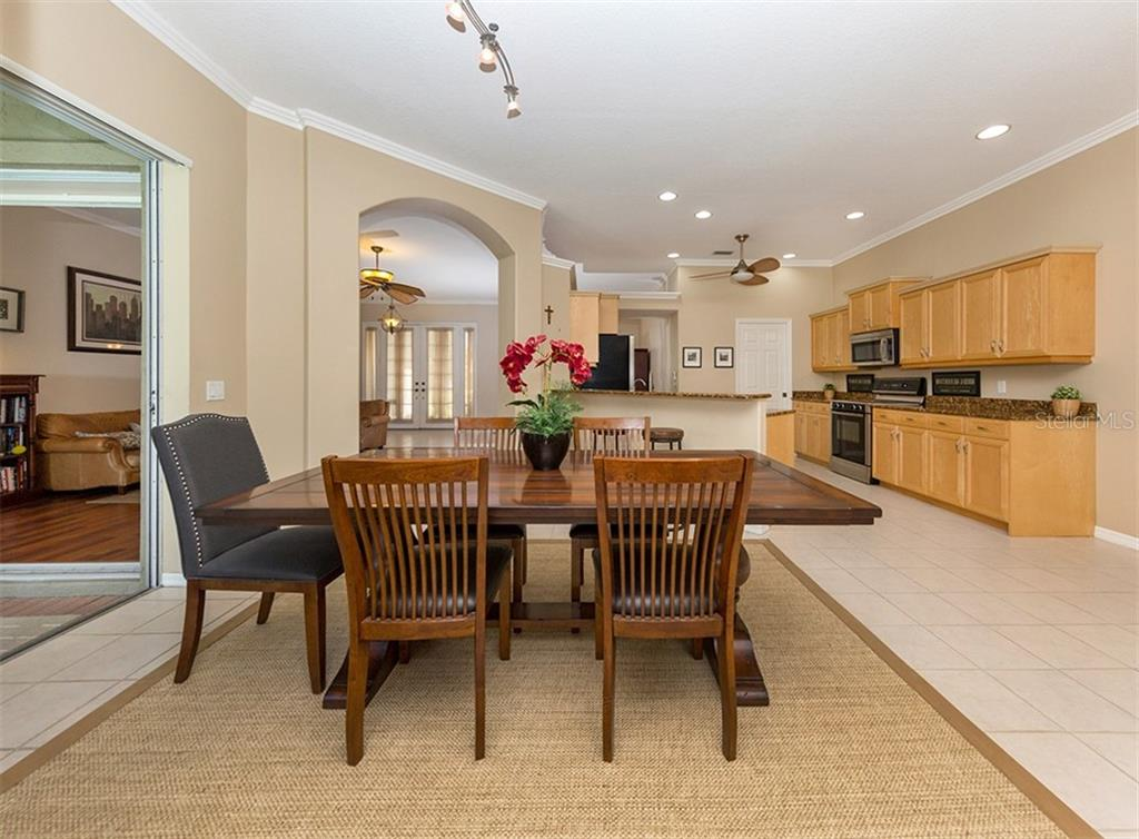 Dining room, kitchen - Single Family Home for sale at 129 Wayforest Dr, Venice, FL 34292 - MLS Number is N6105216