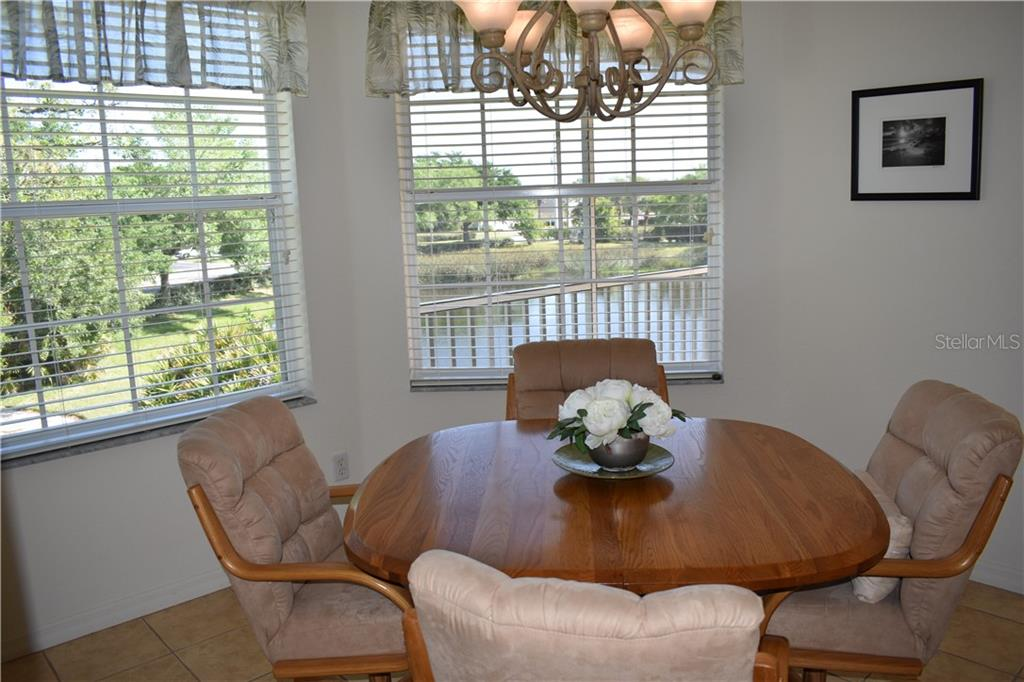 Beautiful view of the pond from your dining room. - Condo for sale at 904 Casa Del Lago Way #904, Venice, FL 34292 - MLS Number is N6105434