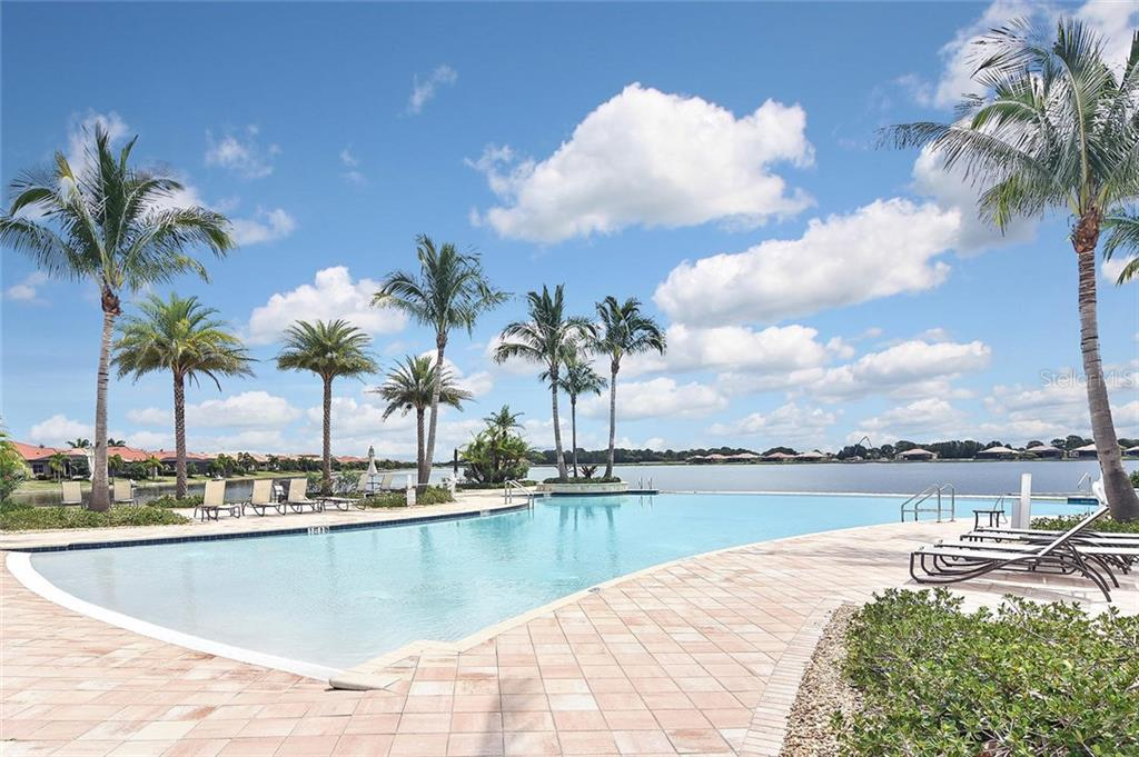Lake view from community pool - Single Family Home for sale at 166 Toscavilla Blvd, Nokomis, FL 34275 - MLS Number is N6105654