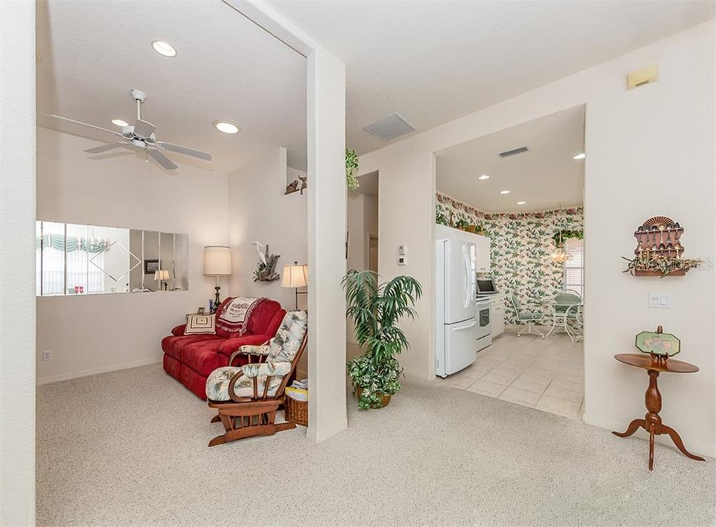 Dining room, foyer, kitchen - Villa for sale at 1230 Berkshire Cir, Venice, FL 34292 - MLS Number is N6105831