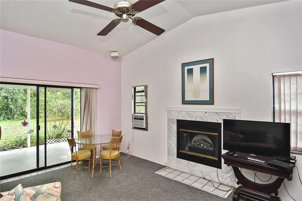 Family room - Single Family Home for sale at 125 Palm Ave E, Nokomis, FL 34275 - MLS Number is N6105973