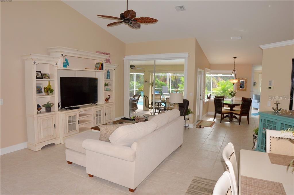 Living room to dinette - Single Family Home for sale at 537 Lake Of The Woods Dr, Venice, FL 34293 - MLS Number is N6106043