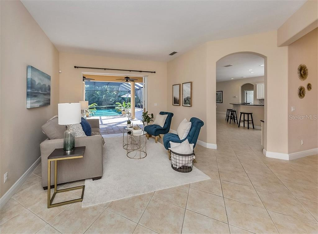 Living room to kitchen - Single Family Home for sale at 106 Vicenza Way, North Venice, FL 34275 - MLS Number is N6106168