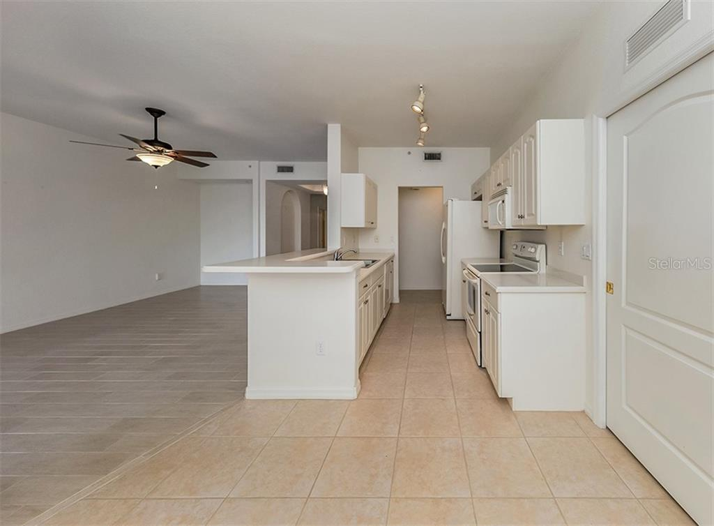 Dinette to kitchen and living room - Condo for sale at 1761 Auburn Lakes Dr #22, Venice, FL 34292 - MLS Number is N6106204