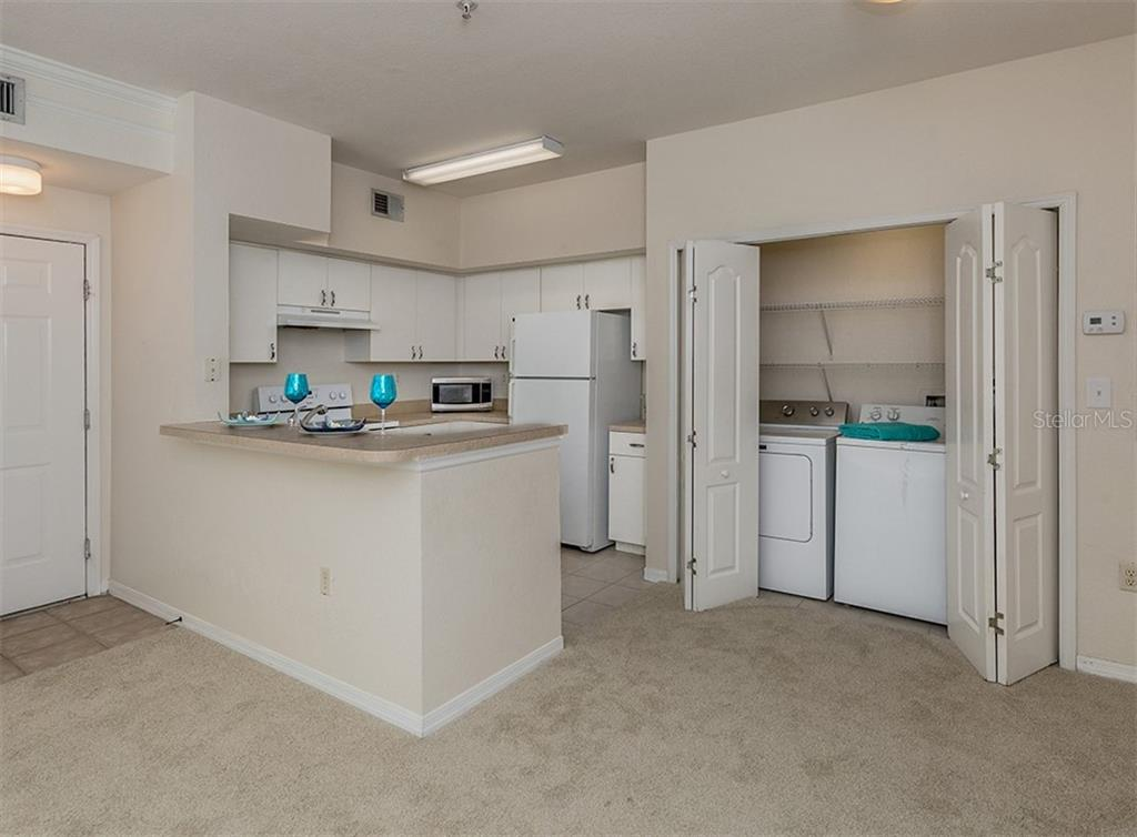 Dining room, laundry, kitchen - Condo for sale at 4110 Central Sarasota Pkwy #123, Sarasota, FL 34238 - MLS Number is N6106210