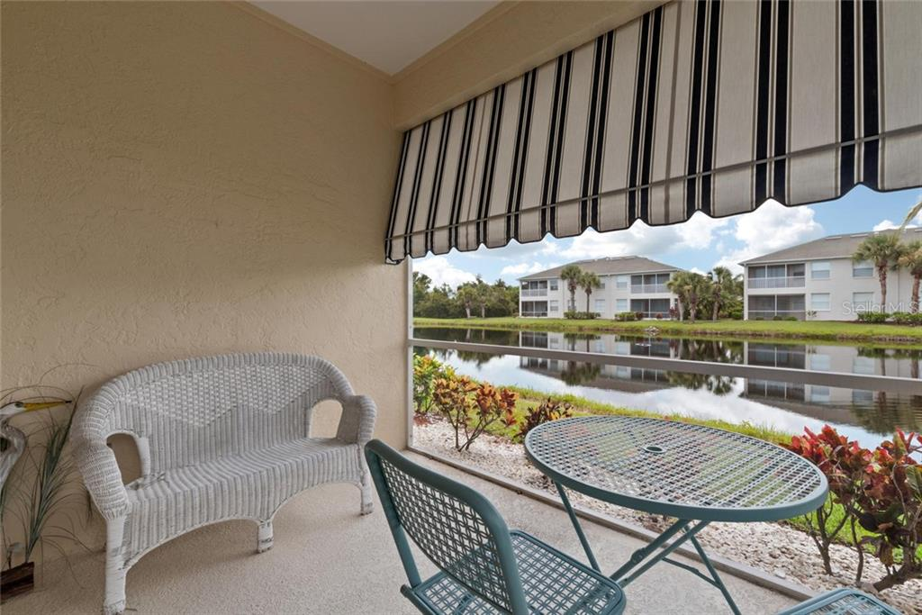 Lanai with water view - Villa for sale at 1708 Fountain View Cir, Venice, FL 34292 - MLS Number is N6106422